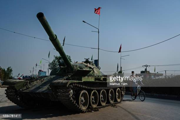 Russian tank with a bridal veil tied to the turret door, an Afghan bike share, outside the Afghan National Army Academy, in Kabul, Afghanistan,...