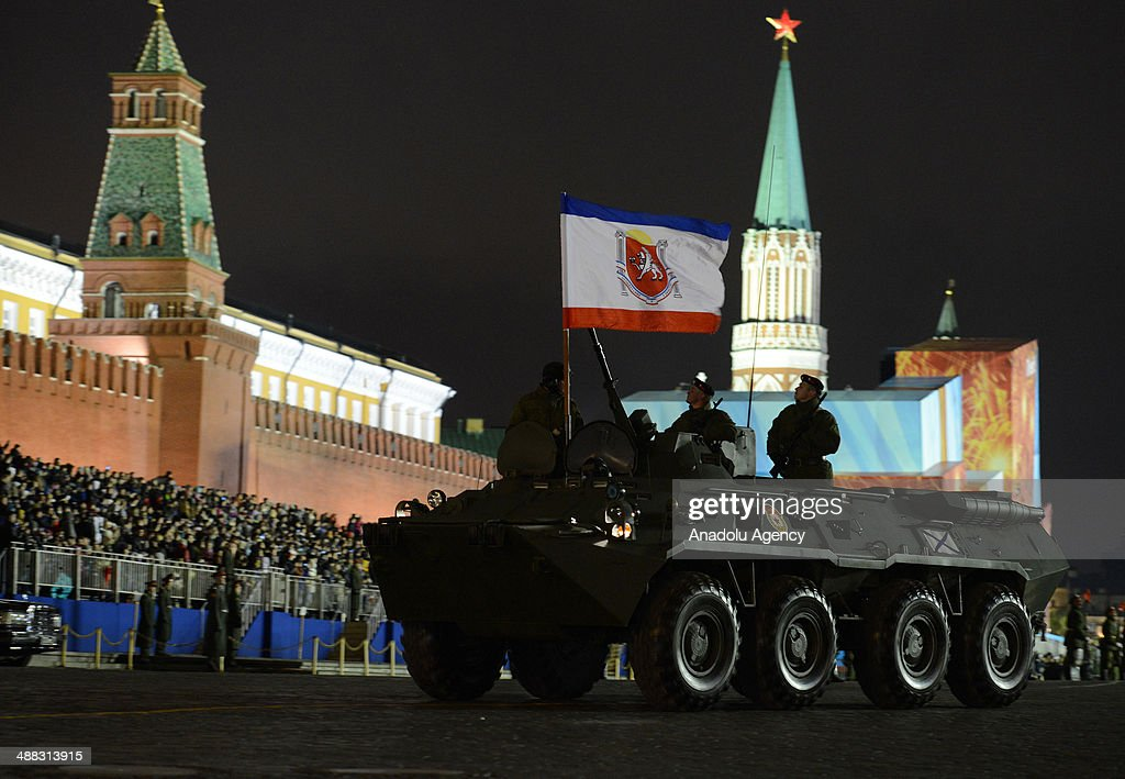 Russian tanks march during a rehearsal of the Victory Day Parade at the Red Square in Moscow, Russia on May 5, 2014. Military vehicles and soldiers attend the rehearsal of Victory Day Parade.