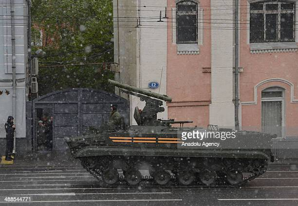 Russian tanks march during a rehearsal of the Victory Day Parade at the Red Square in Moscow Russia on May 7 2014 Military vehicles and soldiers...