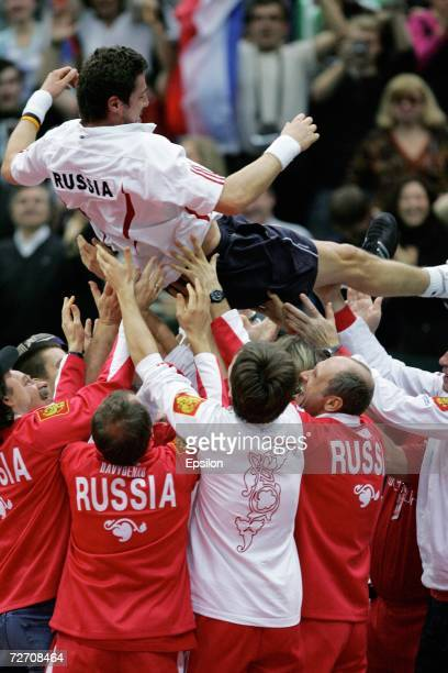 Russian team players carry Marat Safin as they celebrate his victory over Argentinian Jose Acasuso in the final match of the Davis Cup tennis...