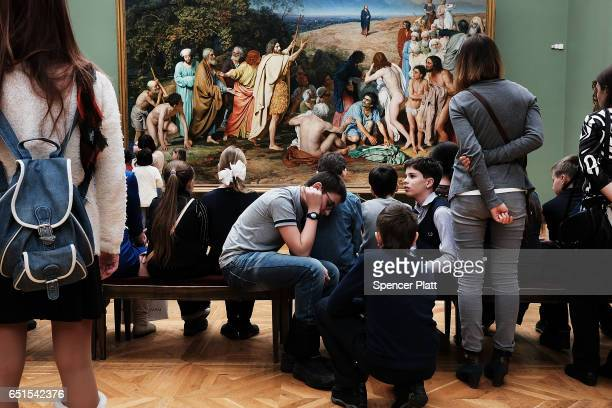 Russian teens visit the Tretyakov Gallery in Moscow on March 10 2017 in Moscow Russia Relations between the United States and Russia are at their...