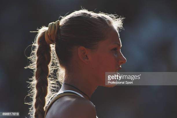 Russian tennis player Anna Kournikova pictured in action competing during progress to reach the fourth round of the Women's Singles tournament at the...