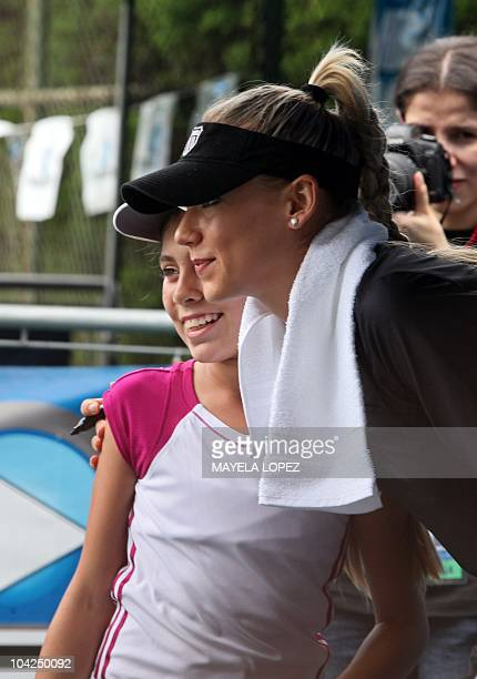 Russian tennis player Anna Kournikova poses for a picture with a fan on September 18 in Heredia 18 kilometers north from San Jose Costa Rica prior to...