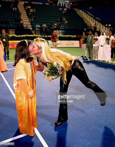 Russian tennis player Anna Kournikova receives flowers from a ball girl during the opening ceremonies of the Dubai Duty Free Womens Tennis Tournament...