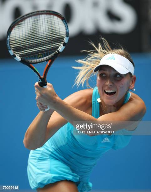 Russian tennis player Elena Vesnina plays a backhand return during her womens singles match against compatriot Maria Sharapova at the Australian Open...