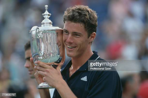 Russian tennis player Marat Safin holds the US Open trophy after beating American tennis player Pete Sampras 64 63 63 to win the final of the Men's...