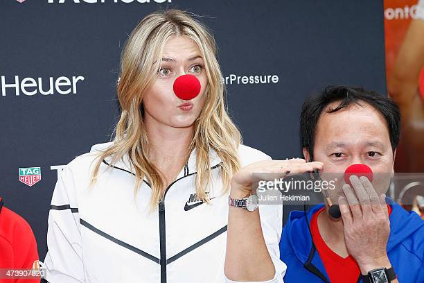 Russian tennis player Maria Sharapova and former American tennis player Michael Chang pose with a red nose to support the Association Theodora fund...