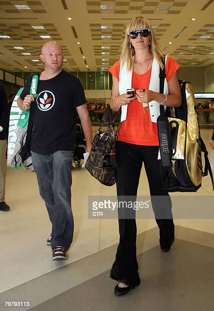 Russian tennis player Maria Sharapova arrives at Doha airport late February 15 2008 Sharapova is scheduled to play at the Qatar Open which starts on...