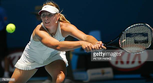 Russian tennis player Maria Sharapova plays a backhand return during her womens singles final match against Serbian opponent Ana Ivanovic at the...
