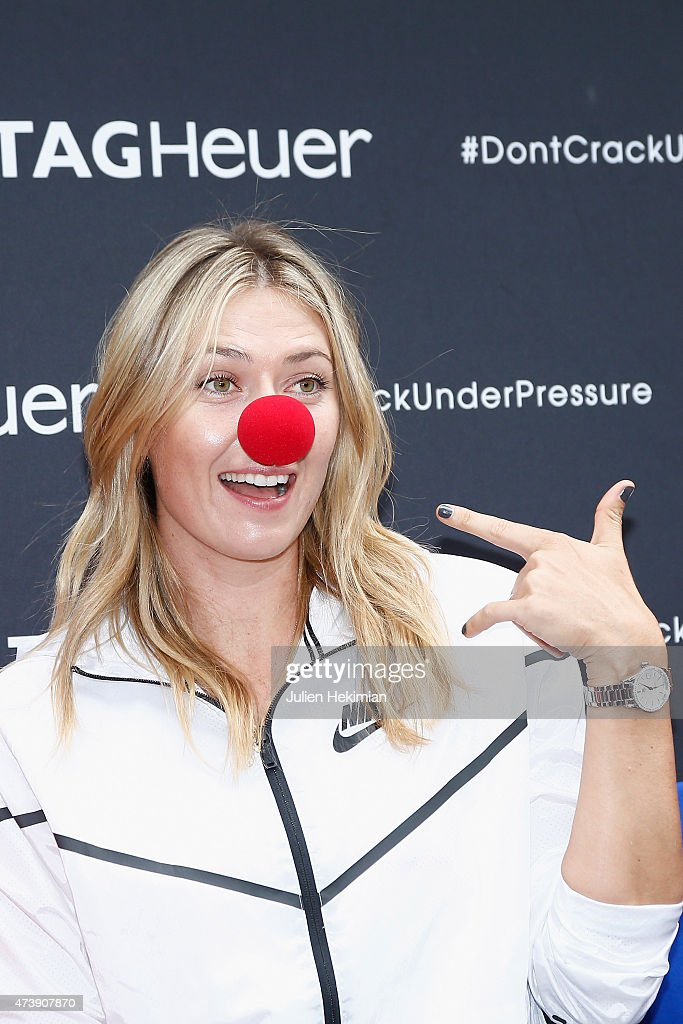 Russian tennis player Maria Sharapova poses with a red nose to support the Association Theodora fund event organized by Tag Heuer on May 18, 2015 in Paris, France.