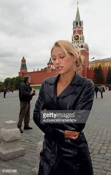 Russian tennis star Anna Kournikova poses 02 October 2002 in front Spasskaya tower on Moscow's Kremlin on Red square after the exhibition tennis...