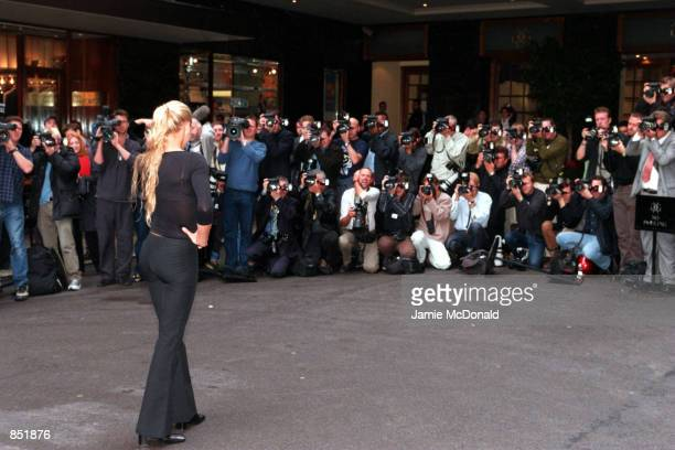 Russian tennis star Anna Kournikova poses for a sea of photographers at a press conference September 19 2000 to announce her new partnership with...