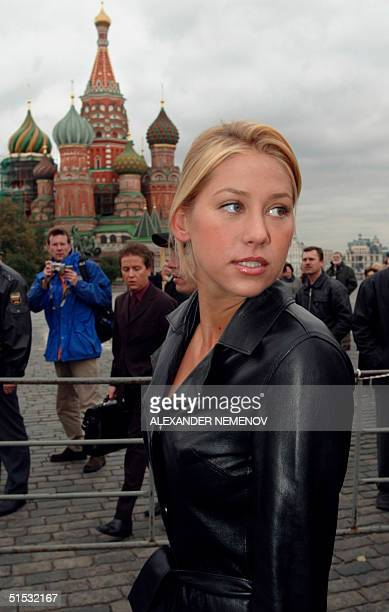 Russian tennis star Anna Kournikova walks along Red square after the exhibition tennis match with Moscow's Mayor Yuri Luzhkov in the capital 02...