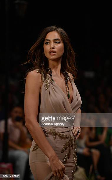 Russian top model Irina Shayk displays a creation during the 18th Dosso Dossi Fashion Show at Antalya Expo Center on June 06, 2014 in Antalya,...