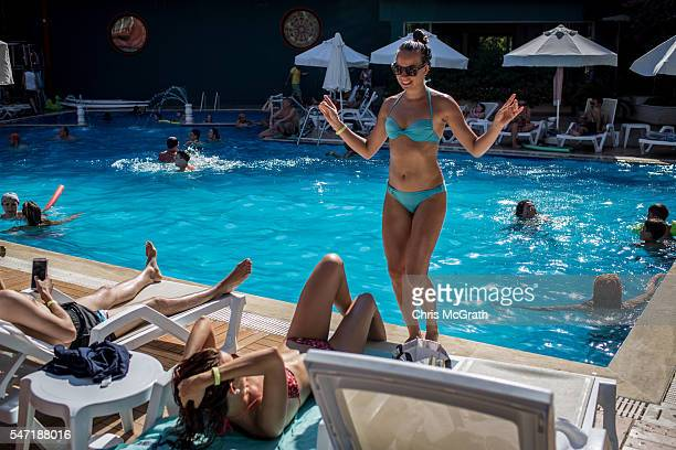Russian tourist Anastasia Goryachih dances poolside at a resort catering to primarily Russian tourists on July 13 2016 in Antalya Turkey Russian...