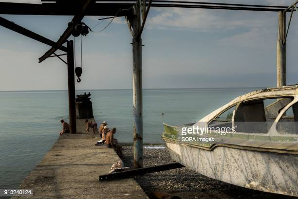 Russian tourists on a former loading station for cruise ships in Sukhumi Abkhazia is a partially recognized state located in north western Georgia...