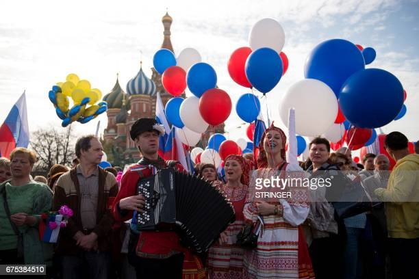 TOPSHOT Russian Trade Unions' members holding balloons and flags parade on Red Square during their May Day demonstration in Moscow on May 1 / AFP...