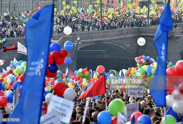 Russian Trade Unions' members parade toward the Red Square in Moscow on May 1 during their May Day demonstration authorised by authorities Russian...