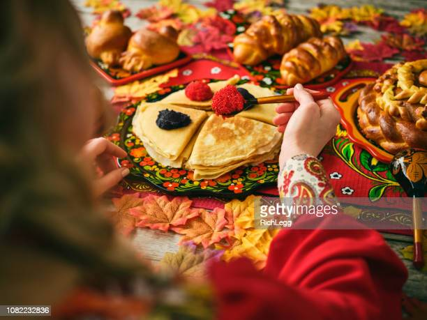 russian traditional blini and caviar on a table - russian culture stock pictures, royalty-free photos & images