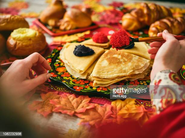 Russian Traditional Blini and Caviar on a Table