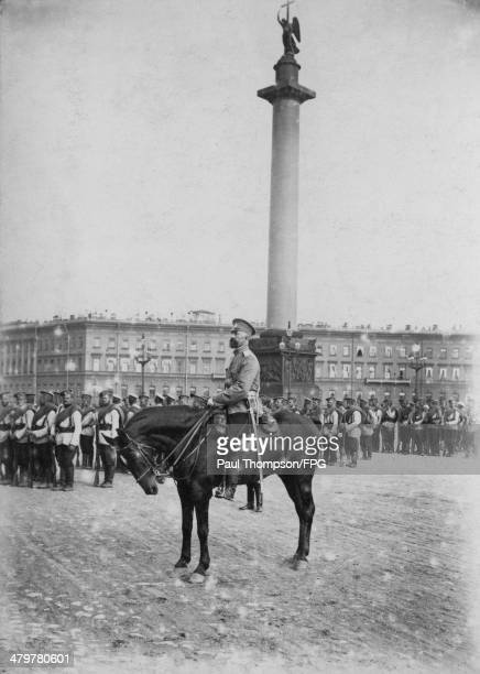 Russian troops amassed in front of the Alexander Column in Palace Square Saint Petersburg Russia circa 1914