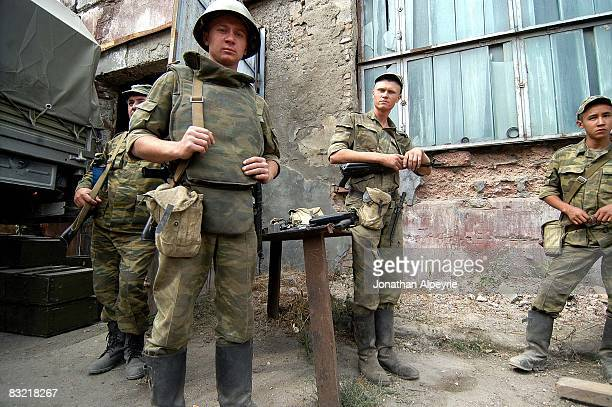 Russian troops guard the entrance of a storage hangar where small weapons are stored on August 16 2008 in the South Ossetian capital city Tskhinvali...