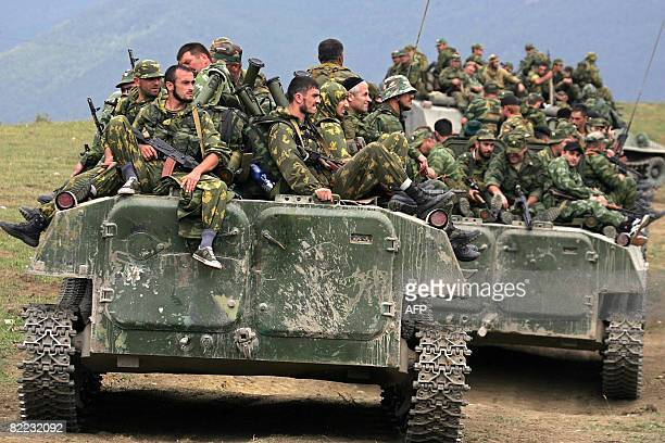 IPTC Russian troops sit on armoured personnel carriers in the South Ossetian town of Dzhava on August 9 2008 Russian Prime Minister Vladimir Putin...