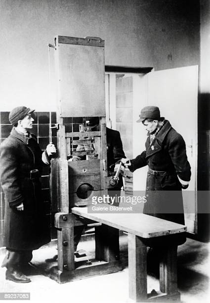 Russian troops with a guillotine or 'Tegel fallbeil' in the Death Chamber at Poznan 1945