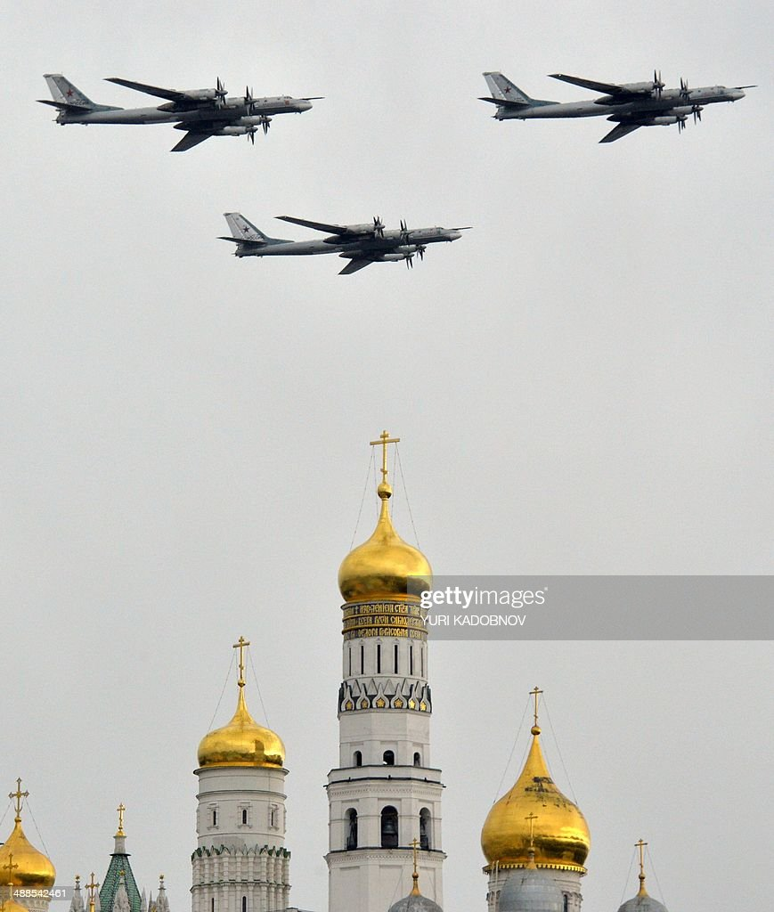 Russian Tupolev Tu-95 turboprop-powered strategic bombers fly above the Kremlin's cathedrals in Moscow, on May 7, 2014, during a rehearsal of the Victory Day parade. Russia celebrates the1945 victory over Nazi Germany on May 9.