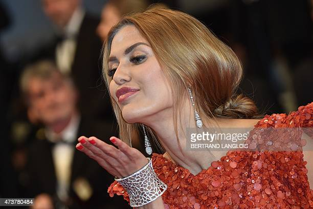 """Russian TV presenter and model Victoria Bonya pose as she arrives for the screening of the film """"Mon Roi"""" at the 68th Cannes Film Festival in Cannes,..."""