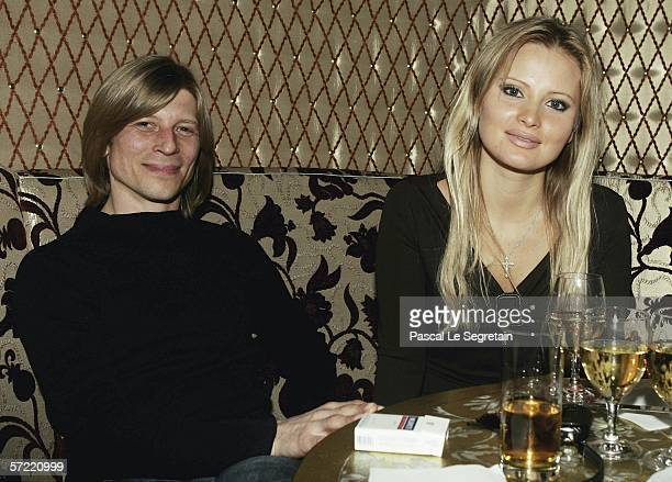 Russian TV presenter Dana Borisova poses with an unidentified guest during the opening Russian Fashion Week Party at the Hermitage Garden on March 29...