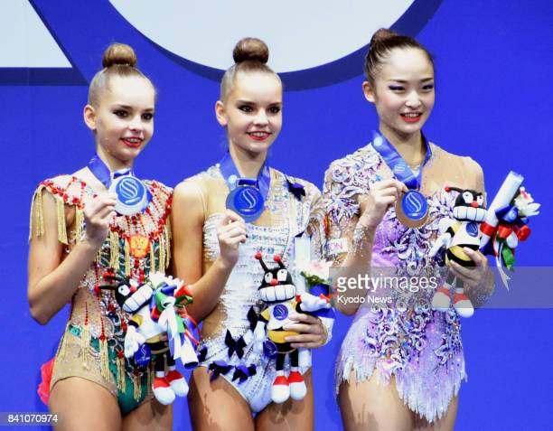 Russian twins Dina Averina and Arina Averina won gold and silver respectively in the individual hoop at the world rhythmic gymnastics championships...