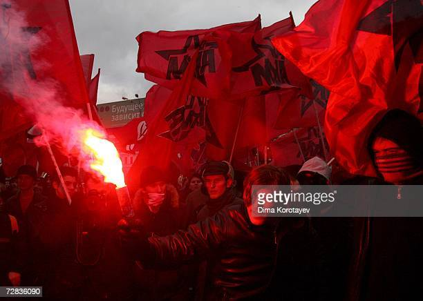 Russian ultraleft radicals light flares during an opposition rally called 'The March of the Unwilling' in the centre of Moscow on December 16 2006 in...