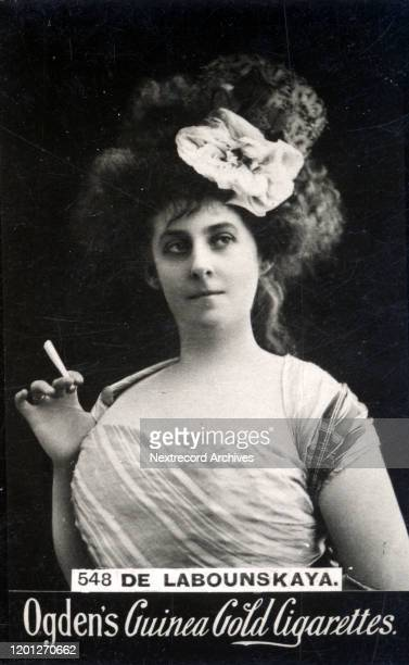 Russian vaudeville stage actress Madame de Labounskaya depicted smoking a cigarette with a sultry expression on the collectible tobacco card from ca...