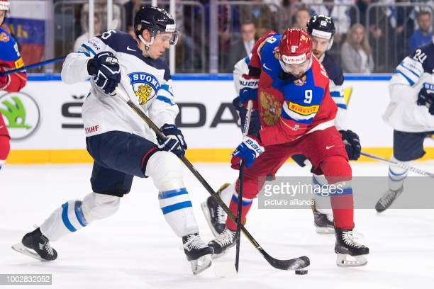 Russian Viktor Antipin and Finland's Atte Ohtamaa vie for the puck during the Ice Hockey World Championship thirdplace match between Finland and...