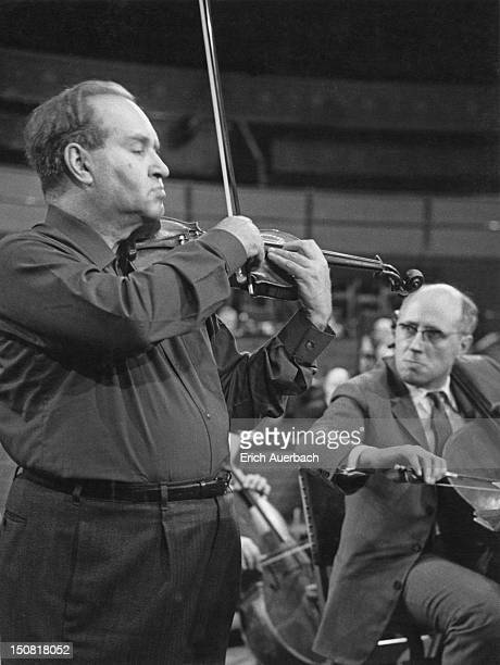 Russian violinist David Oistrakh performing Brahms' Double Concerto with Russian cellist Mstislav Rostropovich and the Moscow Philharmonic Orchestra...