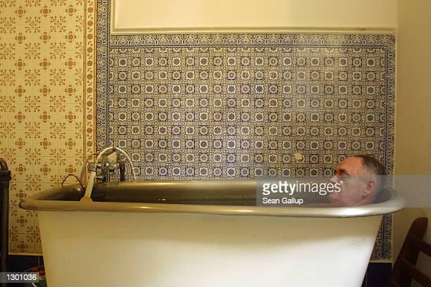 Russian visitor Vadim Kasheyev enjoys a mineral water bath August 6 2002 in the spa town of Marianske Lazne Czech Republic Marianske Lazne known for...