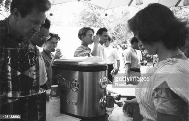 Russian visitors are served icecold Pepsi at the US Exposition in Moscow Moscow Russia 1959