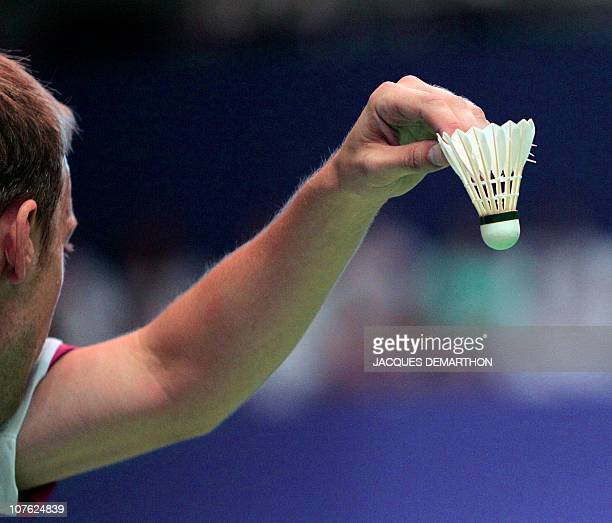 Russian Vitalij Durkin holds the shuttle cock before serving during a mixed double tournament as part of the Badminton World Championships 2010 on...