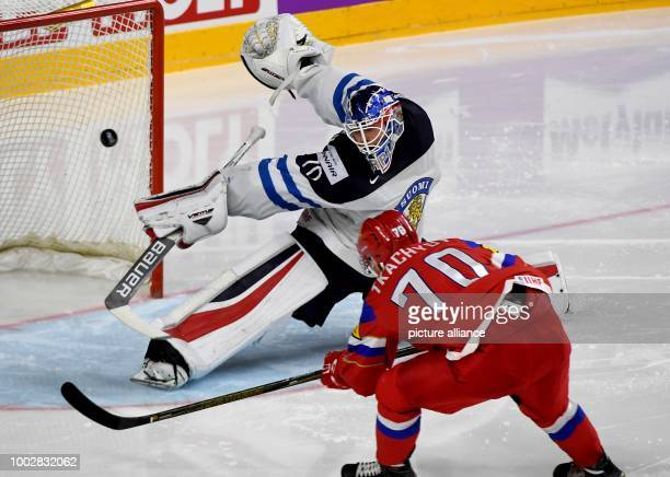 Russian Vladimir Tkatschov defeats Finnish goalkeeper Joonas Korpisalo and scores the 20 during the Ice Hockey World Championship thirdplace match...