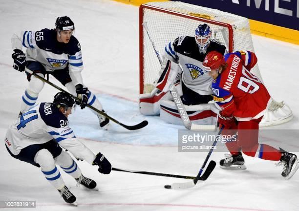 Russian Vladislav Namestnikov attempts to score past Finnish goalkeeper Joonas Korpisalo during the Ice Hockey World Championship thirdplace match...