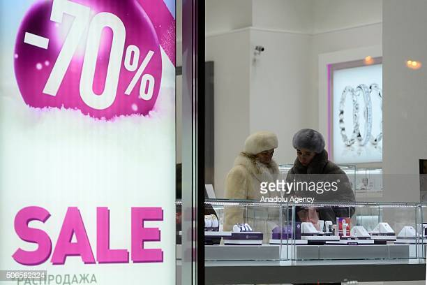 Russian women looks at jewelleries as stores make high discounts after depreciation in Russian Rouble in Moscow Russia on January 24 2016