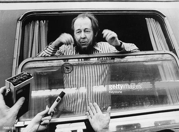 Russian writer and Nobel laureate Alexander Solzhenitsyn is mobbed by journalists on his arrival in Zurich after being deprived of his Soviet...