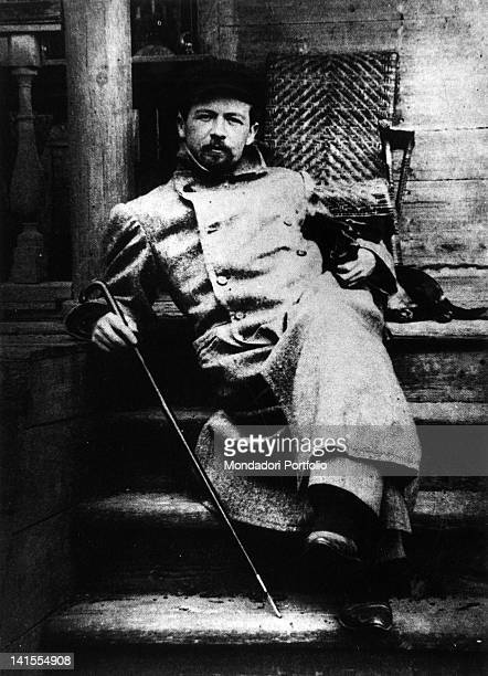 Russian writer and playwright Anton Chekhov sitting on steps