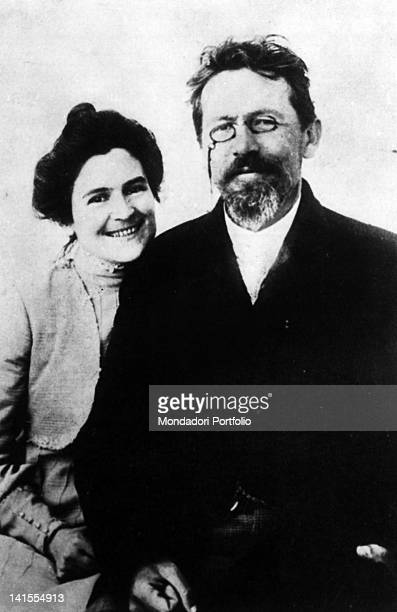 Russian writer and playwright Anton Chekhov smiling with his wife Olga Knipper