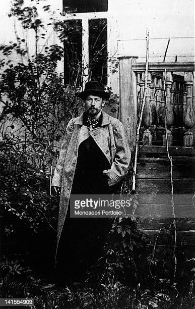 Russian writer and playwright Anton Chekhov standing in a garden
