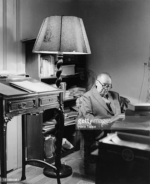 Russian writer Vladimir Nabokov reading in his suite at the Montreux Palace Hotel Montreux Switzerland 1963