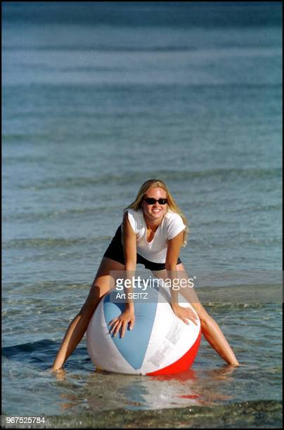 Russian WTA tennis pro Elena Bovina on a beach ball.