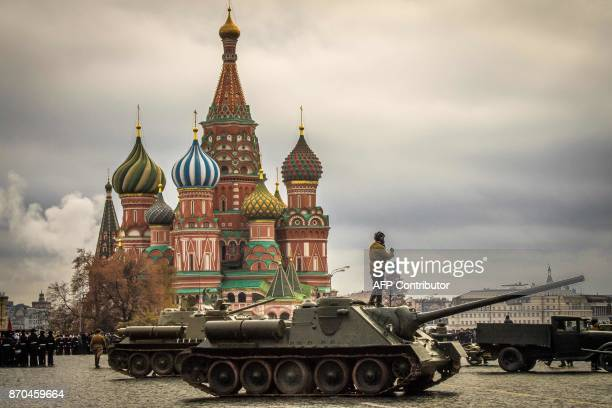 A Russian WWII tank crew member stands on it during the rehearsal for the upcoming parade on Red Square in Moscow on November 5 2017 The event will...