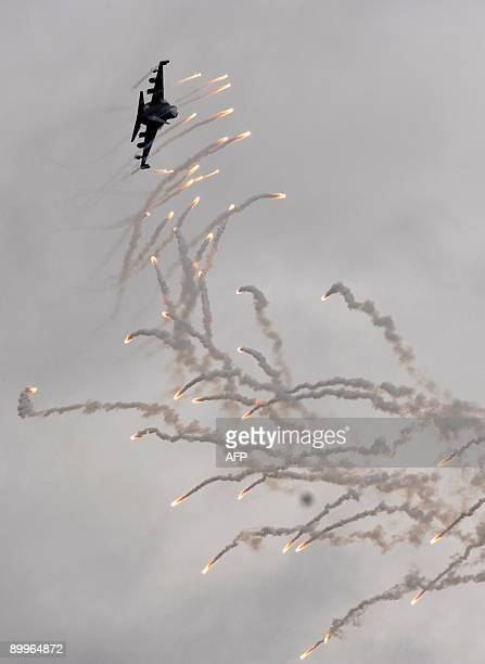 Russian Yak-130 fighter jet shoots flares while perfoming a trick during the MAKS 2009 international aerospace show outside Moscow in Zhukovsky on...
